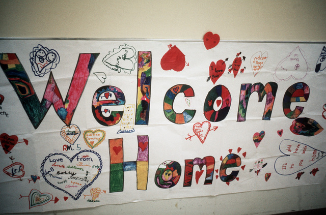 A poster banner, Welcoming Home the ex-POWZs, created by local children on the wall in the Grant Medical Center