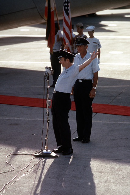 Ex-POW and unidentified U.S. Air Force COL expresses his gratitude to the crowd of well wishers at the flight line microphones. In the background are LGEN William G. Moore Jr., and the Clark AB Honor Guard