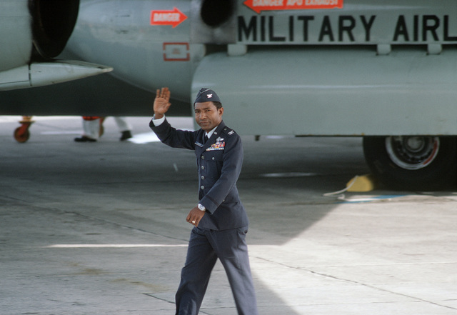Former POW and U.S. Air Force COL Fred Vann Cherry (Captured 22 Oct 65) waves to the public and press there to greet the plane load of former POWs flown in from Clark Air Base. COL Cherry was released by the North Vietnamese in Hanoi on12 Feb 73