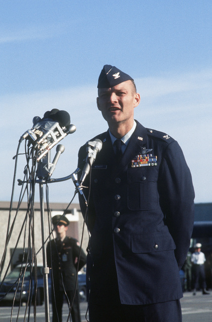 Former POW and U.S. Air Force COL Raymond James Merritt at the microphone, thanks the crowd and press upon arriving on a flight from Clark Air Base. COL Merritt was captured on 16 Sep 65 and released by the North Vietnamese in Hanoi on 12 Feb 73