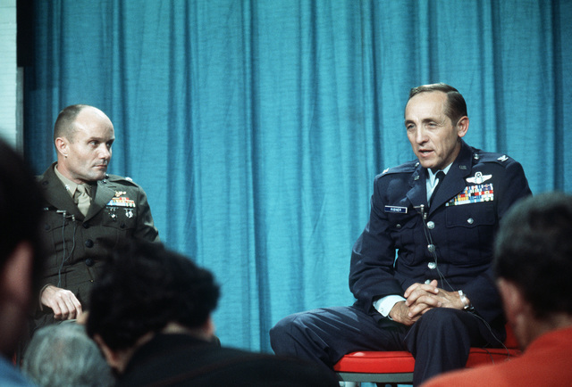 Former POW and U.S. Air Force COL Robinson Risner, (Captured 16 Sep 65) and U.S. Marine LCOL John H. Dunn (Captured 7 Dec 65) answer questions at a press conference. COL Risner and LCOL Dunn was released by the North Vietnamese in Hanoi on 12 Feb 73