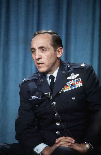 Former POW and U.S. Air Force COL Robinson Risner, (Captured 16 Sep 65) answer questions at a press conference. COL Risner was released by the North Vietnamese in Hanoi on 12 Feb 73