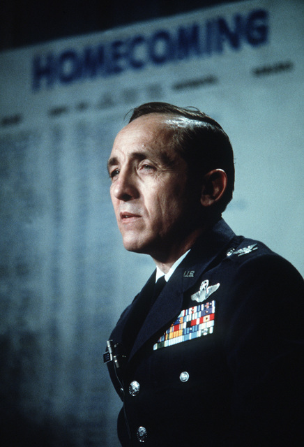 Former POW and U.S. Air Force COLRobinson Risner, (Captured 16 Sep 65) answer questions at a press conference, in the background a Homecoming status board. COL Risner was released by the North Vietnamese in Hanoi on 12 Feb 73