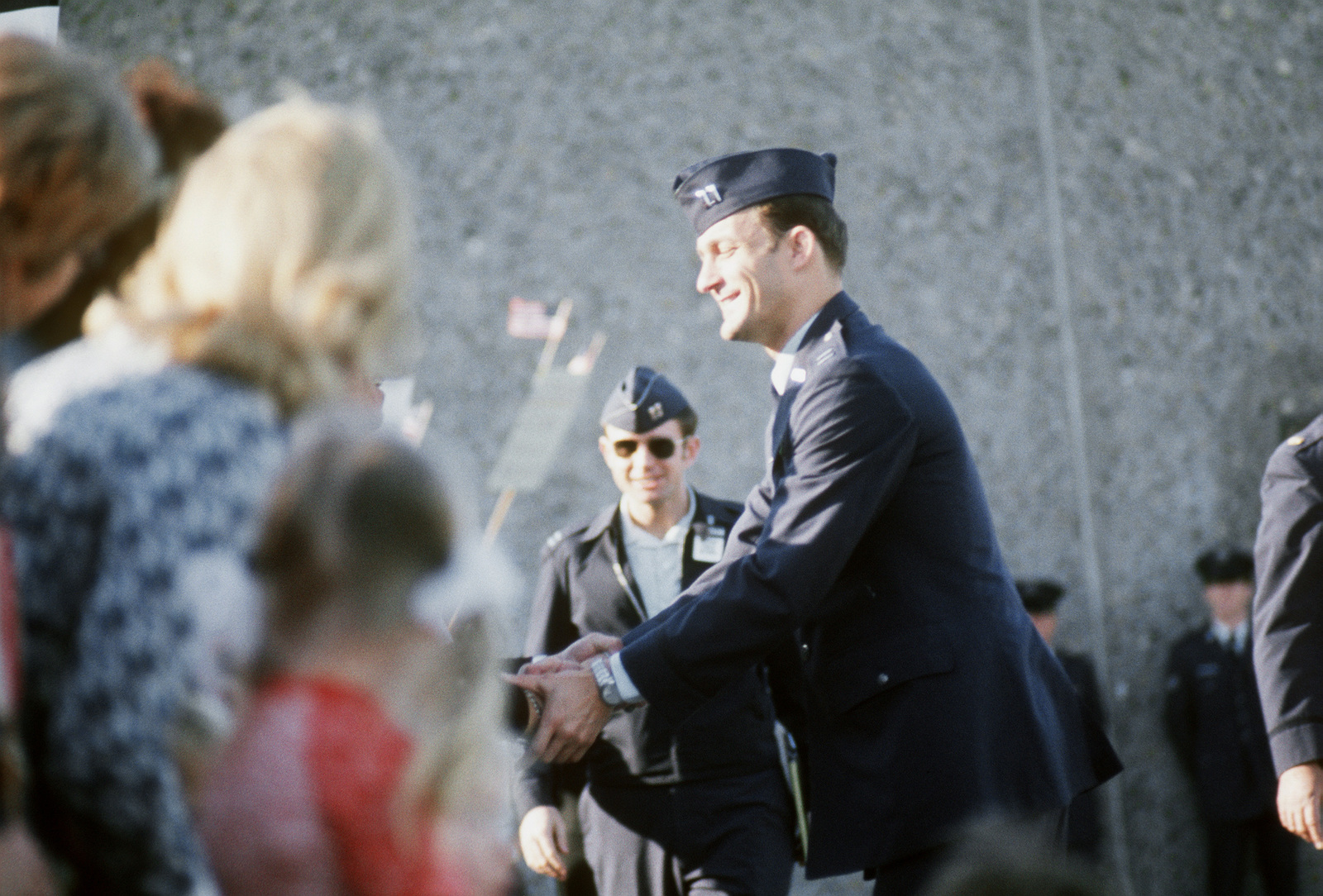 Former POW and U.S. Air Force CPT Edward John Mechenbier is greeted by the crowd of well wishers after his arrival from Clark Air Base, Philippines. CPT Mechenbier was captured on 14 Jun 67 and released by the North Vietnamese in Hanoi on 18 Feb 73