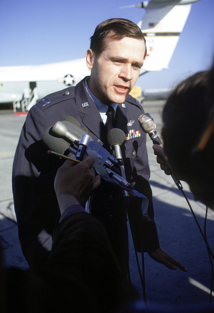 Former POW and U.S. Air Force CPT James Richard Shively answer questions from the press after arriving, via C-141 Starlifter, with fellow POWs from Clark AB, Philippines. CPT Shively was captured on 5 May 67 and released by the North Vietnamese in Hanoi on 18 Feb 73
