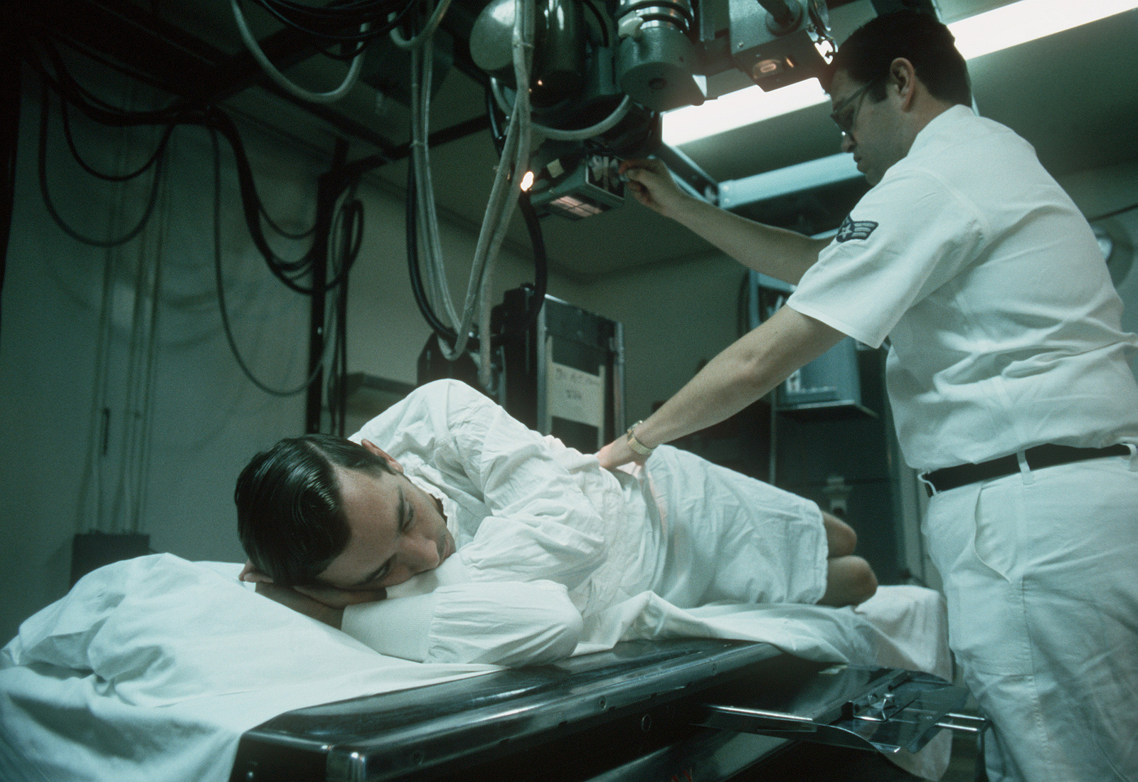 Former POW and U.S. Air Force CPT Lynn E. Guenther is x-rayed by a technician in the Grant Medical Center. CPT Guenther was captured on 26 Dec 71 and released by the North Vietnamese in Hanoi on 12 Feb 73