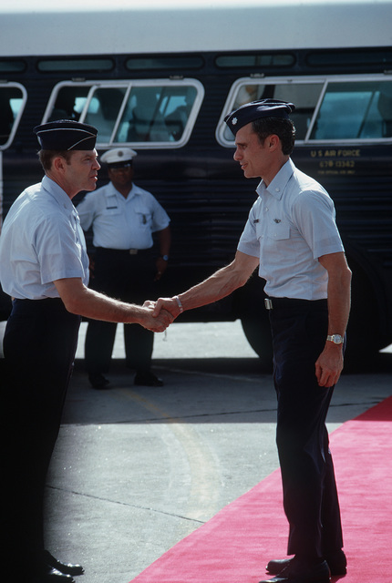 Former POW and U.S. Air Force LCOL Richard P. Keirn (Captured 24 Jul 65) shakes hands with COL Raymond G. Lawry, Deputy Site Commander, Joint Homecoming Reception Center prior to boarding the plane that will return him to the United States
