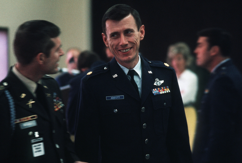 Former POW and U.S. Air Force MAJ Joseph S. Abbott Jr. talks to an Army officer in the lounge. MAJ Abbott was captured on 20 Apr 67 and released by the North Vietnamese in Hanoi on 18 Feb 73