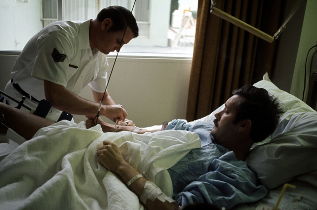 Former POW and U.S. Air Force SSGT Roy Madden Jr. has a blood sample taken by a medical technician in his hospital bed at the Grant Medical Center. SSGT Madden was captured on 22 Dec 72 and released by the North Vietnamese in Hanoi 12 Feb 73