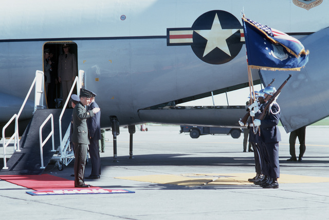 Former POW and U.S. Army CPT George K. Wanat Jr salutes the flag after being welcomed by MGEN John Gonge, Commander, 22nd Air Force and BGEN William Dietrich, Vice Commander, 22nd Air Force upon his arrival from Clark Air Base, Philippines. CPT Wanat was captured by the Viet Cong on 30 Apr 72 and was released at Loc Ninh on 12 Feb 73