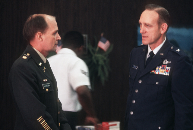 Former POW and U.S. Army MAJ Raymond Cecil Schrump talks with BGEN William Deitrich, Vice Commander 22nd Air Force in the passenger lounge after his arrival from Clark Air Base, Philippines. MAJ Schrump was captured on 23 May 68 in South Vietnam and released by the Viet Cong at Loc Ninh on 12 Feb 73