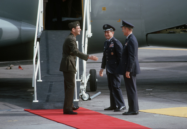 Former POW and U.S. Marine LCOL Edison Wainright Miller (Captured 13 Oct 67) is greeted by MGEN John Gonge, Commander 22nd Air Force and BGEN William Deitrich, 22nd AF Vice CO on his arrival from Clark Air Base. LCOL Miller was released by the North Vietnamese in Hanoi on12 Feb 73