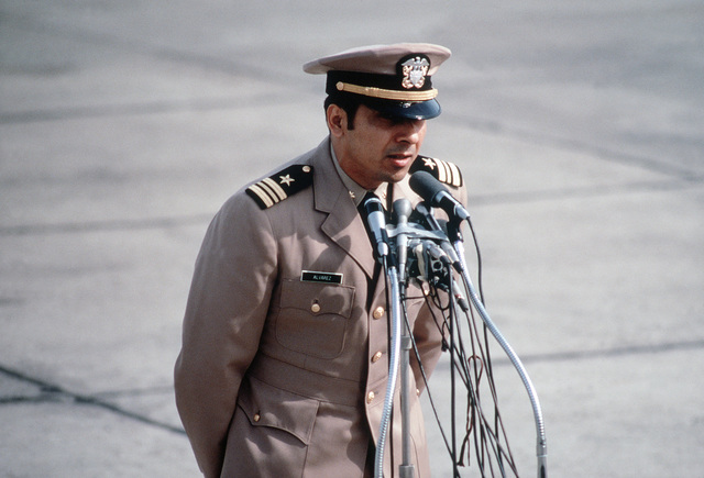 Former POW and U.S. Navy LCMDR Everett Alvarez (Captured 5 Aug 64) talks at the microphones to the public and press there to greet the plane load of former POWs flown in from Clark Air Base. LCMDR Alvarez was released by the North Vietnamese in Hanoi on12 Feb 73