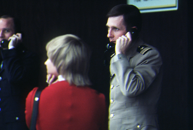 Former POW and U.S. Navy LCMDR Frederick R. Purrington talks on the phone in the lounge. LCMDR Purrington was captured on 20 Oct 66 and released by the North Vietnamese in Hanoi on 18 Feb 73