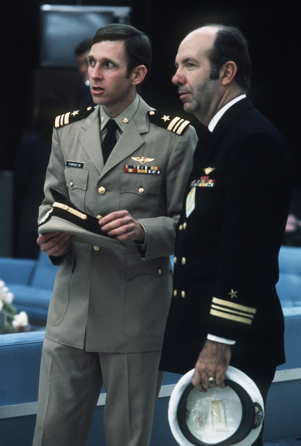 Former POW and U.S. Navy LCMDR Frederick R. Purrington with Navy officer in the lounge. LCMDR Purrington was captured on 20 Oct 66 and released by the North Vietnamese in Hanoi on 18 Feb 73