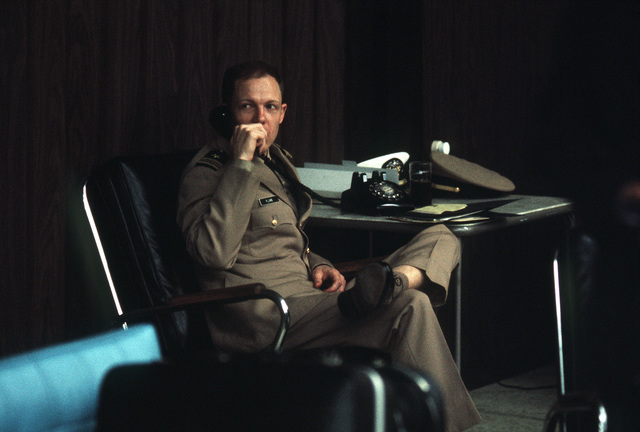 Former POW and U.S. Navy LCMDR Joseph Charles Plumb Jr. talks on the phone in the lounge. LCMDR Plumb was captured on 19 May 67 and released by the North Vietnamese in Hanoi on 18 Feb 73