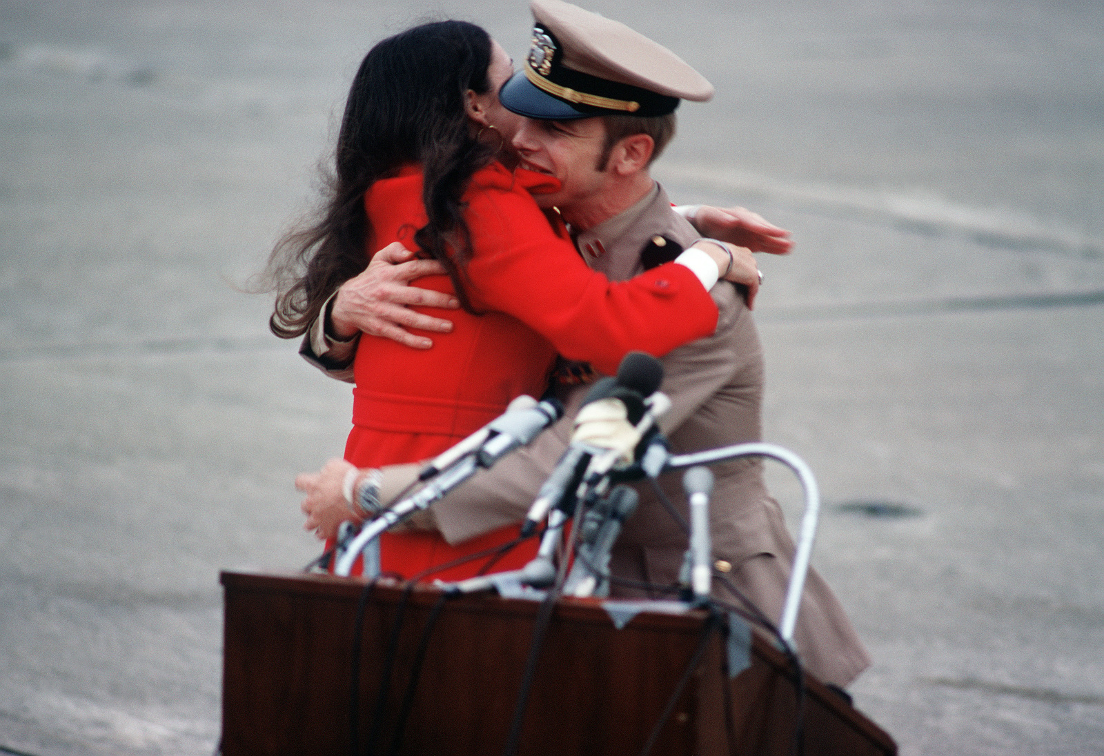 Former POW and U.S. Navy LT Kenneth H. Higdon is greeted by a loved one on the ramp. LT Higdon was captured on 21 Dec 72 and released by the North Vietnamese in Hanoi 12 Feb 73