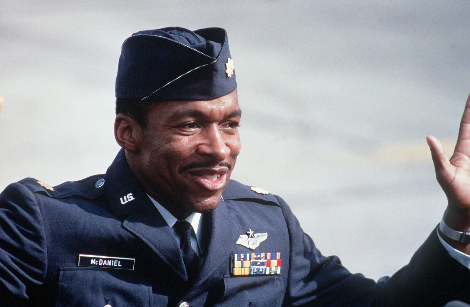 Former POW and U.S.Air Force MAJ Norman Alexander McDaniel (Captured 20 Jul 66) express delight at the reception he received from the public and the press on his arrival from Clark Air Base. MAJ McDaniel was released by the North Vietnamese in Hanoi on12 Feb 73