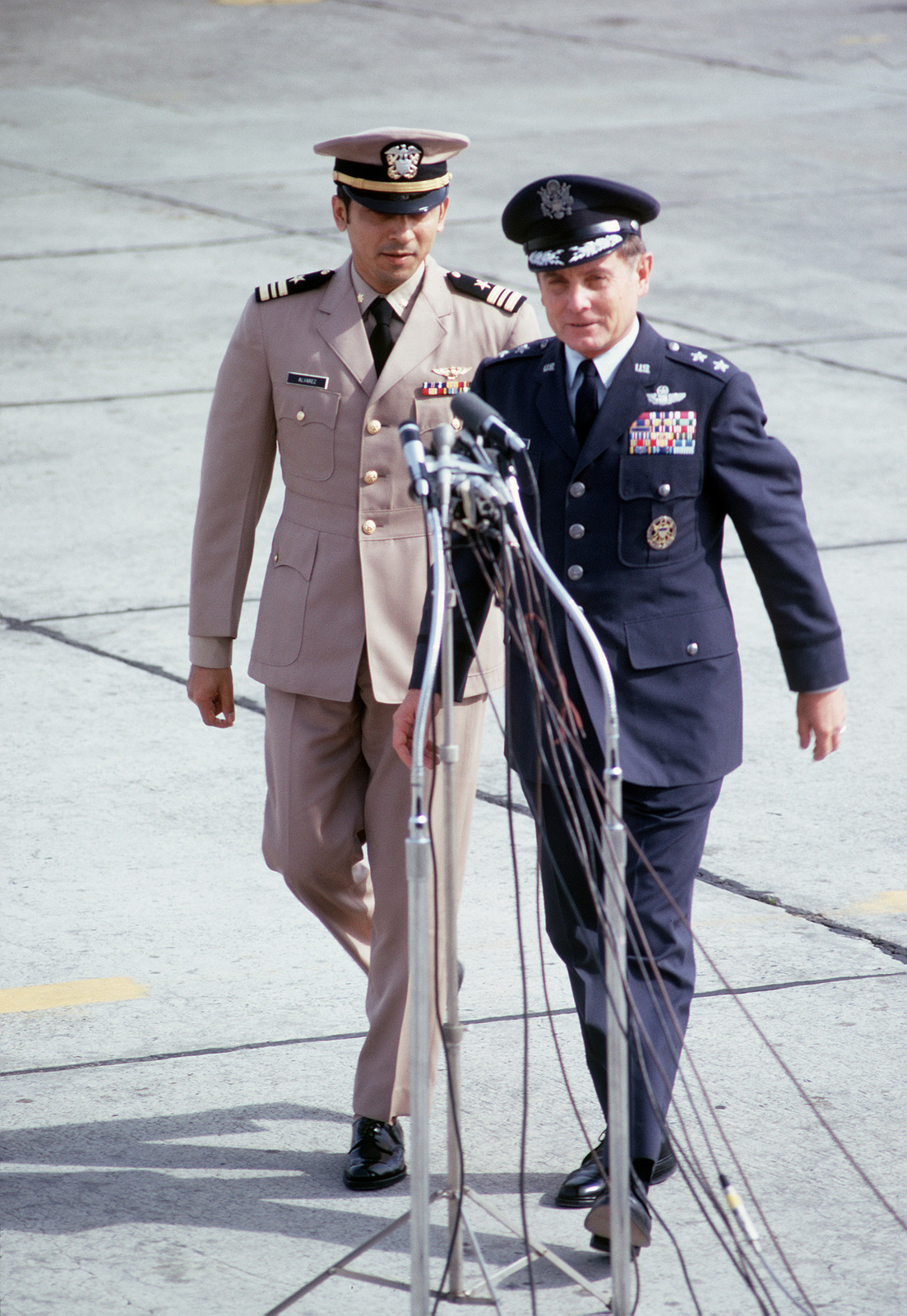 Former POW and U.S.Navy LMDR Everett Alvarez (Captured 5 Aug 64) is lead to the microphones by MGEN John Gonge, 22nd Air Force Commander after his arrival from Clark Air Base. LCMDR Alvarez was released by the North Vietnamese in Hanoi on 12 Feb 73