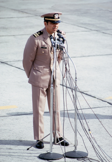 Former POW and U.S.Navy LMDR Everett Alvarez (Captured 5 Aug 64) talks at the microphones to the public and press there to greet the plane load of former POWs flown in from Clark Air Base. LCMDR Alvarez was released by the North Vietnamese in Hanoi on 12 Feb 73