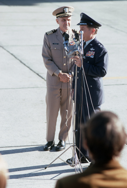 Gonge, 22nd Air Force Commander, at the flight line microphones, welcomes former Prisoner of War, U.S. Navy CPT James Bond Stockdale to Travis. CPT Stockdale was captured by the North Vietnameses on 9 Sep 65 and was released in Hanoi on 12 Feb 73