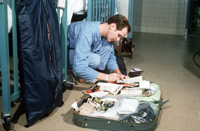 In the Clark AB hospital, released Prisoner of War, U.S. Navy CMDR John Bryan McKamey (Captured 2 June 65) packs his suitcase for the trip back to the United States. CMDR McKamey was in the first group of POWs released by North Vietnam at Hanoi on February 12, 1973
