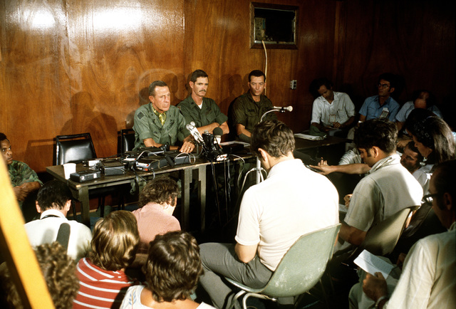 Overrall view as BGEN Stan McClellan, CHIEF of STAFF Military Assistance Command-Vietnam (MACV), U.S. Army, conducts a press conference, to discuss the details of release of the prisoners of war, for members of the civilian press in a Military Assistance Command-Vietnam (MACV) briefing room at Tan Son Nhut Airbase
