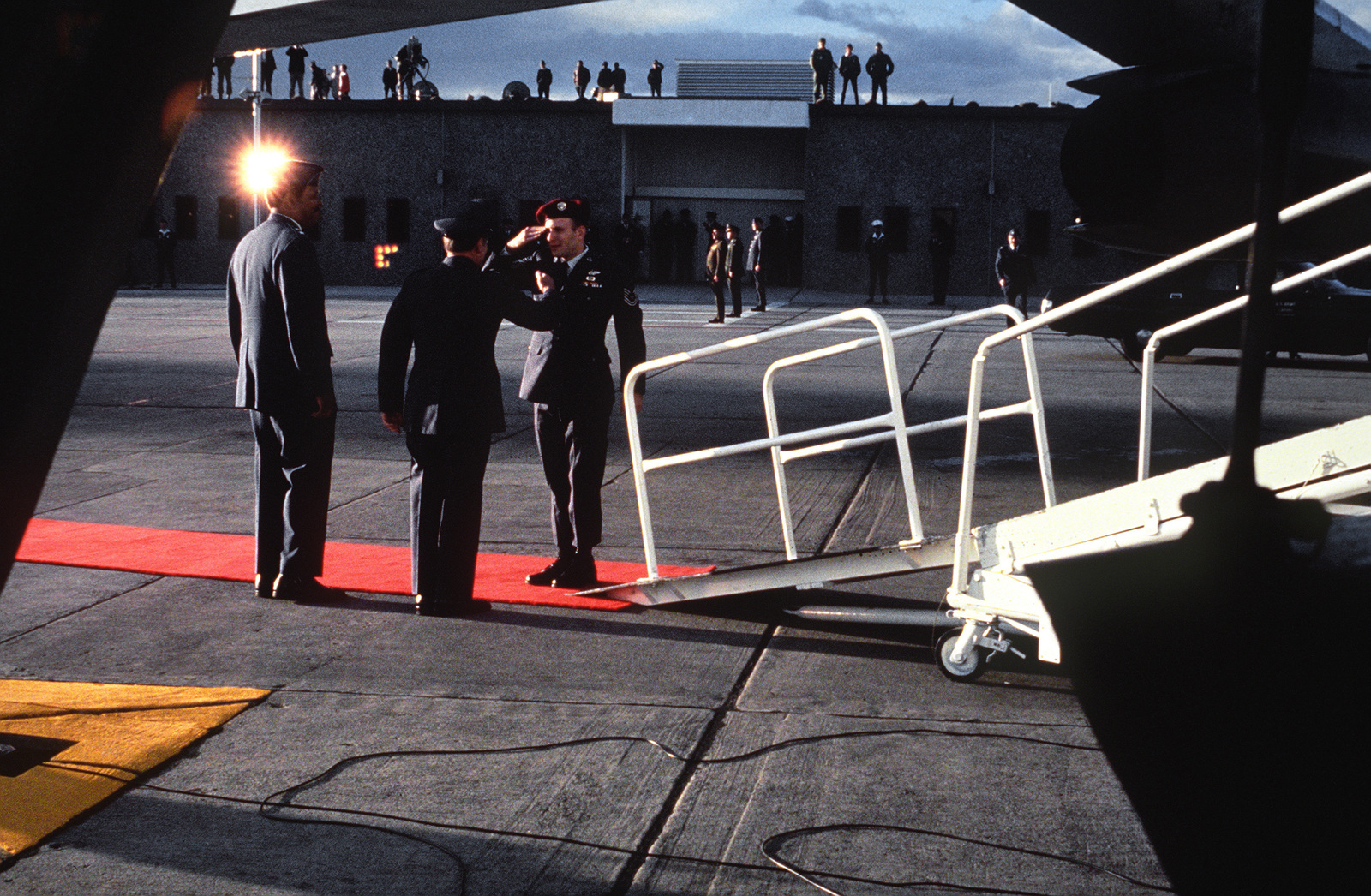 """Released Prisoner of War, U.S. Air Force TSGT Arthur Neil Black, (Captured 20 Sep 65)) salutes MGEN John Gonge, 22nd Air Force Commander and MGEN Daniel """"Chappie"""" James upon his arrival at Travis Air Force Base. TSGT Black was in the second group released by the North Vietnamese on Feb 12, 1973 in Hanoi"""