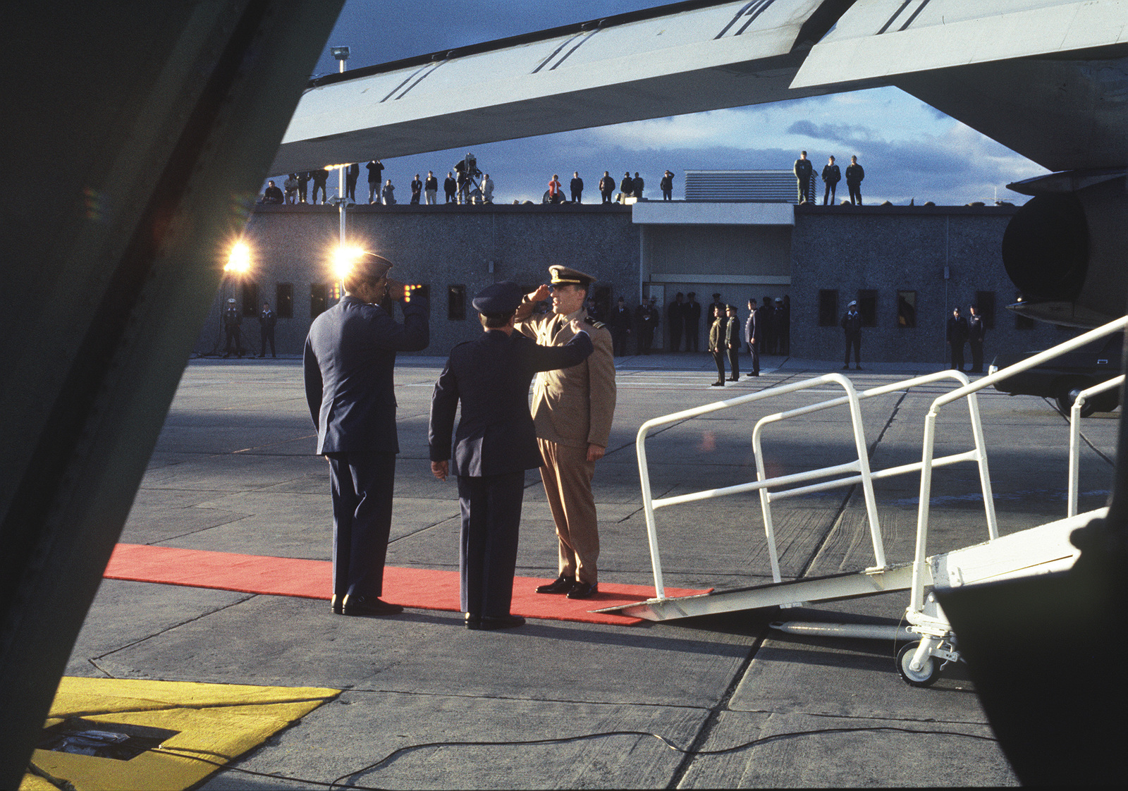"""Released Prisoner of War, U.S. Navy LT CMDR Larry Howard Spencer, (Captured 18 Feb 66)) salutes MGEN John Gonge, 22nd Air Force Commander and MGEN Daniel """"Chappie"""" James upon his arrival at Travis Air Force Base. LT CMDR Spencer was in the third group released by the North Vietnamese on Feb 12, 1973 in Hanoi"""