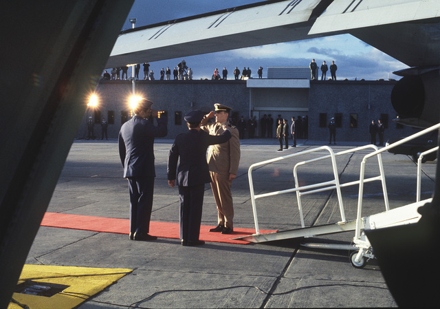 "Released Prisoner of War, U.S. Navy LT CMDR Larry Howard Spencer, (Captured 18 Feb 66)) salutes MGEN John Gonge, 22nd Air Force Commander and MGEN Daniel ""Chappie"" James upon his arrival at Travis Air Force Base. LT CMDR Spencer was in the third group released by the North Vietnamese on Feb 12, 1973 in Hanoi"