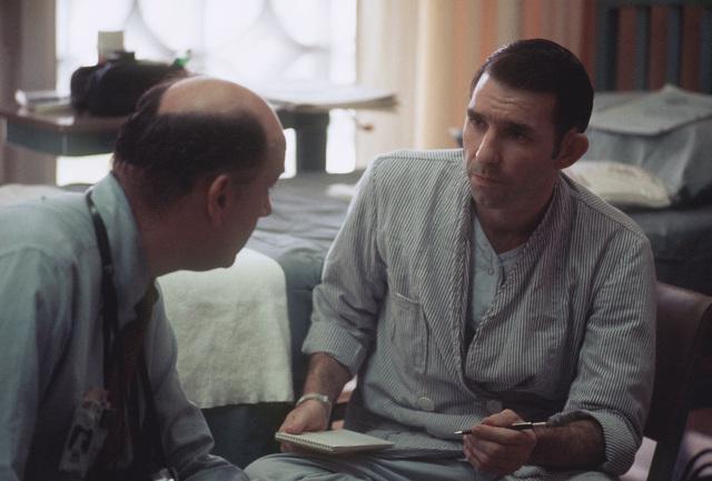 Returned POW U.S. Air Force MAJ Wesley Duane Schierman (Captured 28 Aug 65) talks with Navy artist, Mr. Benton, in his hospital room. MAJ Schierman was released by the North Vietnamese in Hanoi on 12 Feb 73 in Hanoi