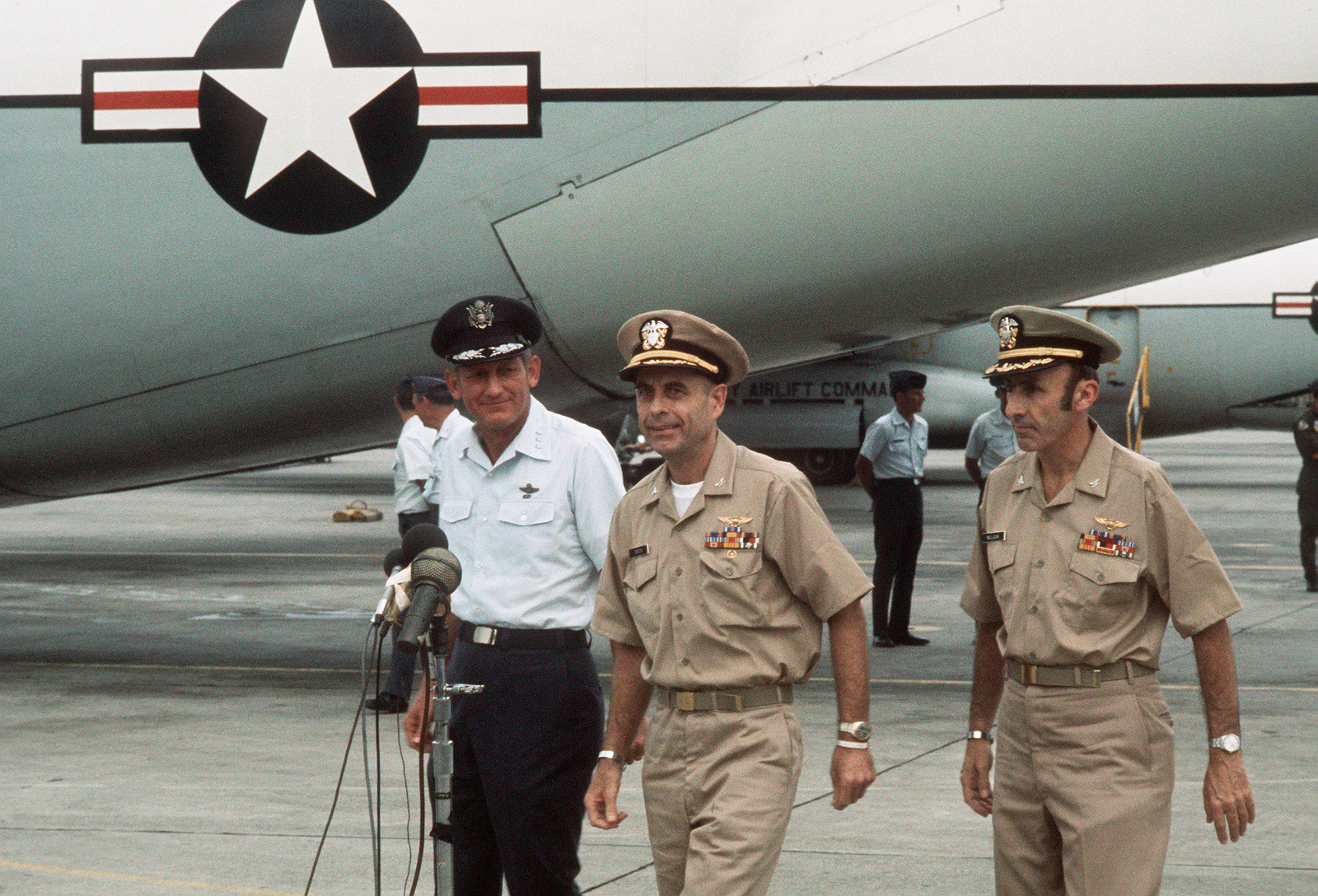 Returned POWs U.S. Navy CPT Jeremiah Andrew Denton (on left), (Captured 18 Jul 65) and Navy CPT James Alfred Mulligan, (Captured 20 Mar 66) along with 13th Air Force Commander, LGEN William G. Moore approach the microphones on the flight line for a farewell statement prior to board the C-141 Starlifter for the trip from Clark AB to sthe states. Both Denton and Mulligan were released by the North Vietnamese in Hanoi on 12 Feb 73 in Hanoi