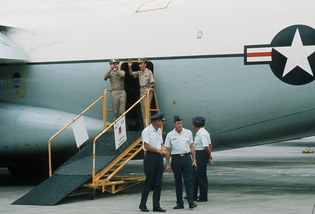 Returned POWs U.S. Navy CPT Jeremiah Andrew Denton (on left), (Captured 18 Jul 65) and Navy CPT James Alfred Mulligan, (Captured 20 Mar 66) as they board the C-141 Starlifter for the trip from Clark AB to sthe states. Both Denton and Mulligan were released by the North Vietnamese in Hanoi on 12 Feb 73 in Hanoi