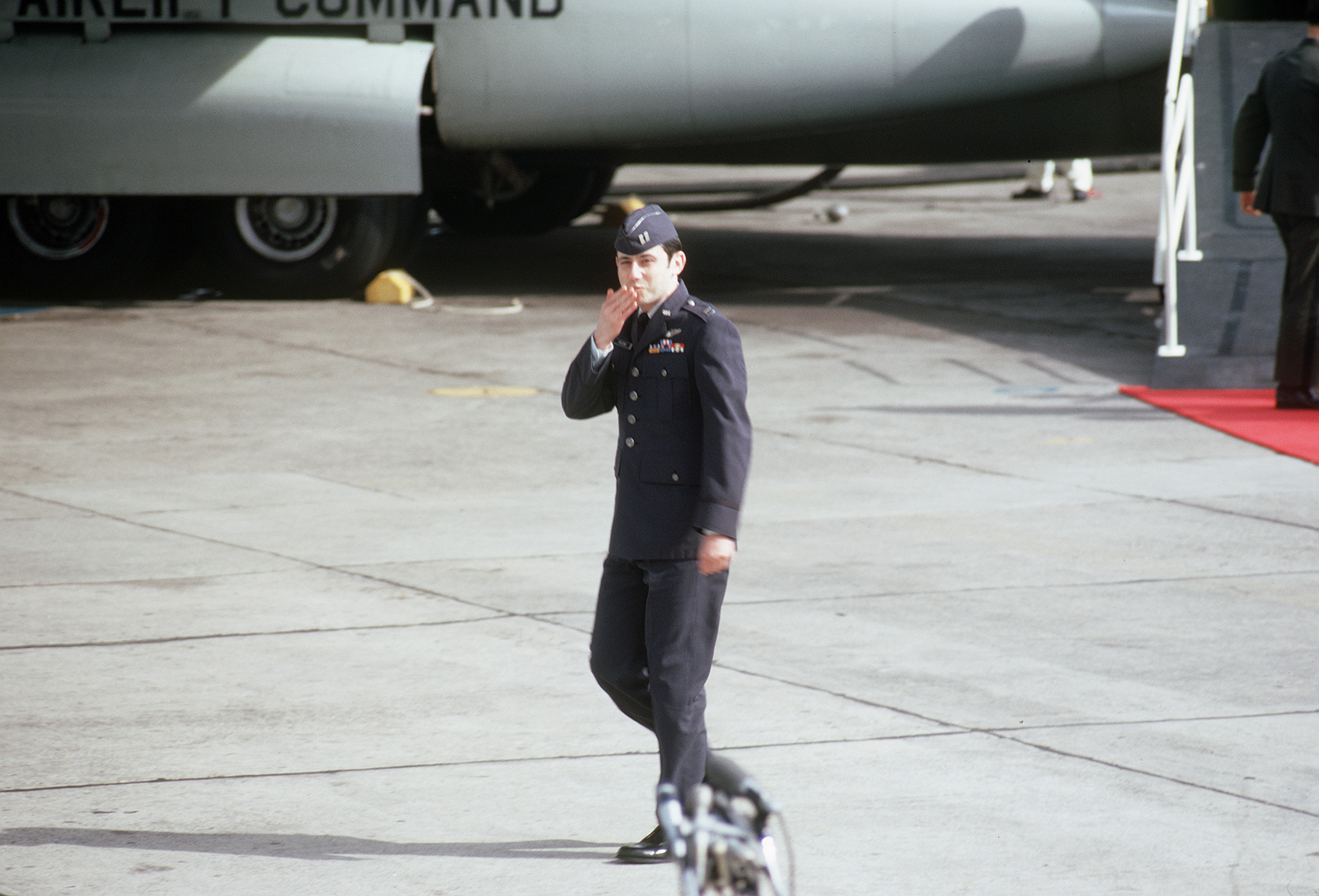 Unidentified former POW/U.S. Air Force Captain blows a kiss to the public and press there to greet the plane load of former POWs flown in from Clark Air Base