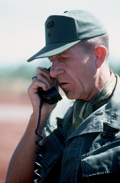 BGEN Stan McClellan, U.S. Army, CHIEF of STAFF, Military Assistance Command - Vietman (MACV), talks on the radio during the pending exchange of American and South Vietnamese prisoners for Viet Cong (VC) and North Vietnamese (NVA) prisoners with Viet Cong officer