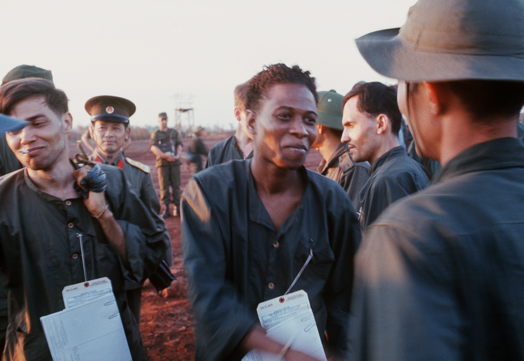 Ex-POW U.S. Army SGG Bobby Louis Johnson (Captured 25 Aug 68), talks with a Viet Cong official after his released by the Viet Cong to the American Military. He is one of the twenty eight American POWs released by Viet Cong on February 12, 1973