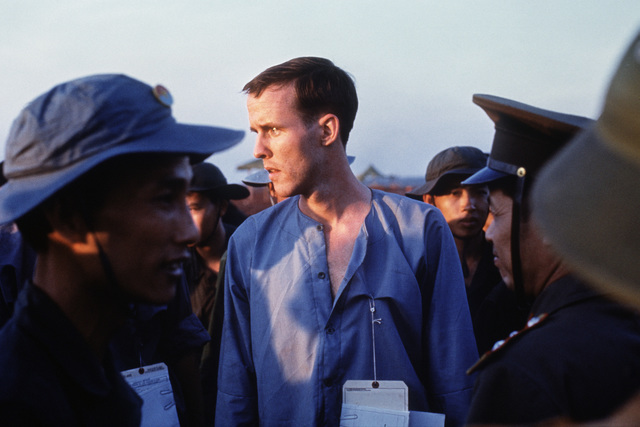 Ex-POW U.S. Army SGT Kenneth Wallingford (Captured 7 Apr 72) in a group of Viet Cong and North Vietnamese Army personnel after his released by the Viet Cong to the American Military. He is one of the twenty eight American POWs released by Viet Cong on February 12, 1973