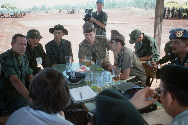 Members of the United Nation's International Commission of Control and Supervision and the Four Power Joint Military Commission discuss the release of the prisoners of war. U.S. Army's BGEN Stan McClellan, CHIEF of STAFF, Military Assistance Command - Vietnam (MACV) the American representative is shown on the left