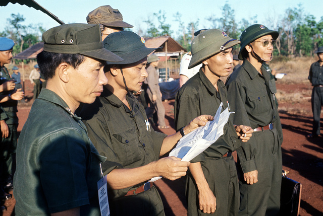Representative of the Viet Cong military review the list of names of prisoners of war under their control prior to the formal exchange of American and South Vietnamese POWs for POWs held by the South Vietnamese and American forces