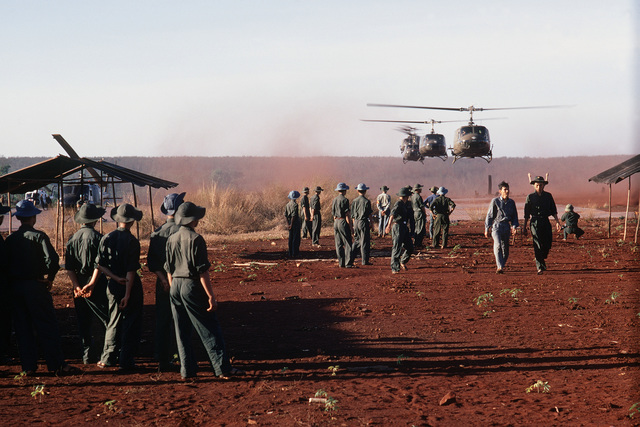 The Huey H-1 helicopters, carrying the members of the United Nation's International Commission of Control and Supervision who will observe the exchange American and South Vietnamese prisoners for Viet Cong (VC) and North Vietnamese (NVA) prisoners, approach the exchange location
