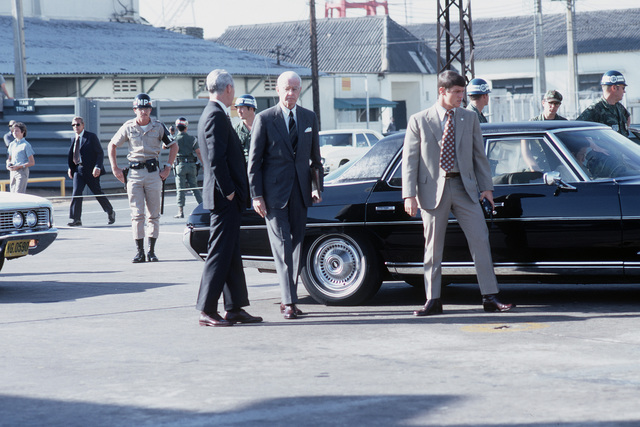 U.S. Ambassador Ellsworth Bunker arrives at Tan Son Nhut Air Base in his automobile to observe the departure of Viet Cong POWs for Loc Ninh prisoner exchange between the United States/South Vietnam and North Vietnam/Viet Cong militaries