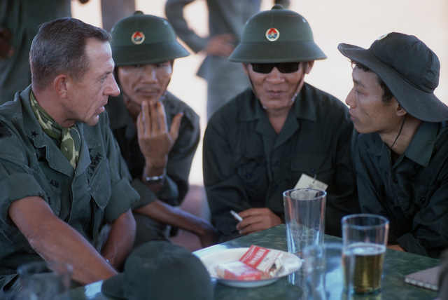 U.S Army's BGEN Stan McClellan, CHIEF of STAFF, Military Assistance Command - Vietnam (MACV) the American representative and Viet Cong and North Vietnamese members of the Four Power Joint Military Commission discuss the release of their respective prisoners of war
