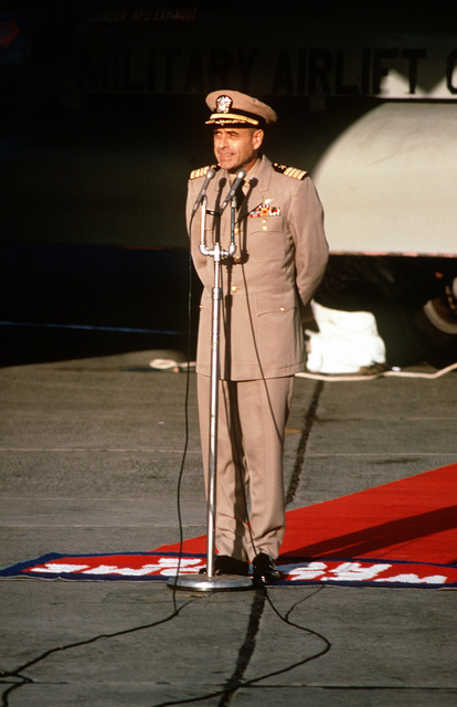Former POW and U.S. Navy CPT Jeremiah Andrew Denton (Captured 18 Jul 65) stands at the microphones and talks to the crowd of well wishers and press upon his arrival on the C-141 Starlifter from Clark Air Base, Philippines. CPT Denton was in the first group of POWs released by the North Vietnamese government in Hanoi