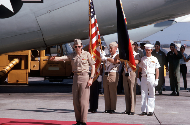 In front of the Honor Guard, ex-POW and U.S.Navy CMDR Frederick Raymond Purrington (Captured 20 Oct 66), salutes the press and well wishers prior to boarding the C-141 Starlifter that will transport him to the United States. LCMDR Purrington released in Hanoi by North Vietnam on 18 Feb 73