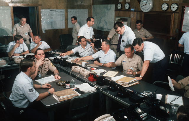 Members of the Joint Service Processing Team gathered in the Joint Service Processing Center Command Post. Cheif of the Army Homecoming team is COL James A. Murphey Jr., U.S. Army. Deputy for the Air Force Homecoming operation is COL Raymond G. Lawry assigned to the 405th CSG