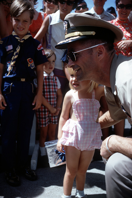 Ex-POW and U.S. Navy CPT Ernest Milvin Moore Jr., (Captured 11 Mar 67) talks to some of the children who came to the flight line to say goodbye as he leaves for the United States. CPT Moore was released in Hanoi by North Vietnam on 4 Mar 73