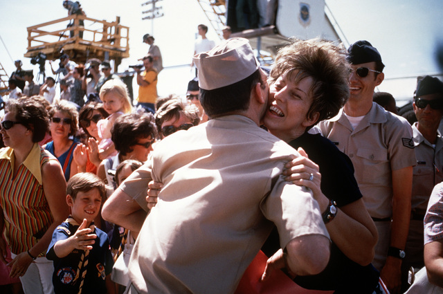 Unidentified U.S. Navy, ex-POW gets a hug from one of the many well wishers who came to the flight line to say goodbye as he leaves for the United States