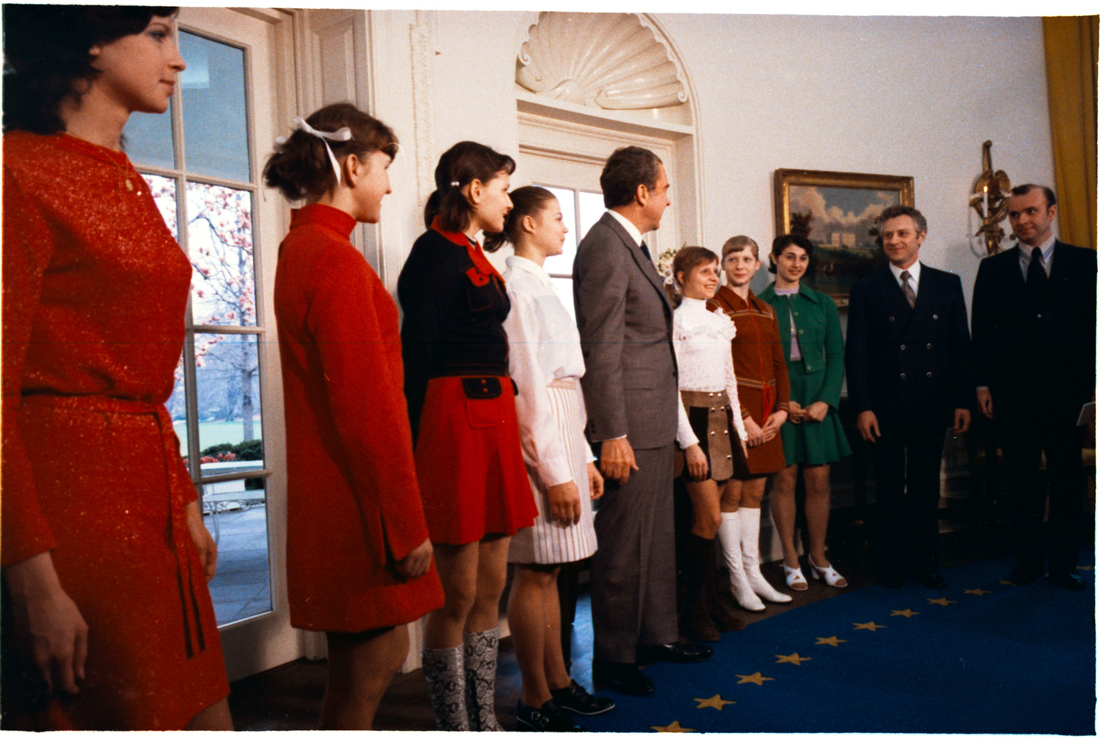 President Richard Nixon Standing in the Oval Office with Members of the Russian Soviet Women's Gymnastics Team, Olympic Gold Medalist Olga Korbut Stands next to Richard Nixon