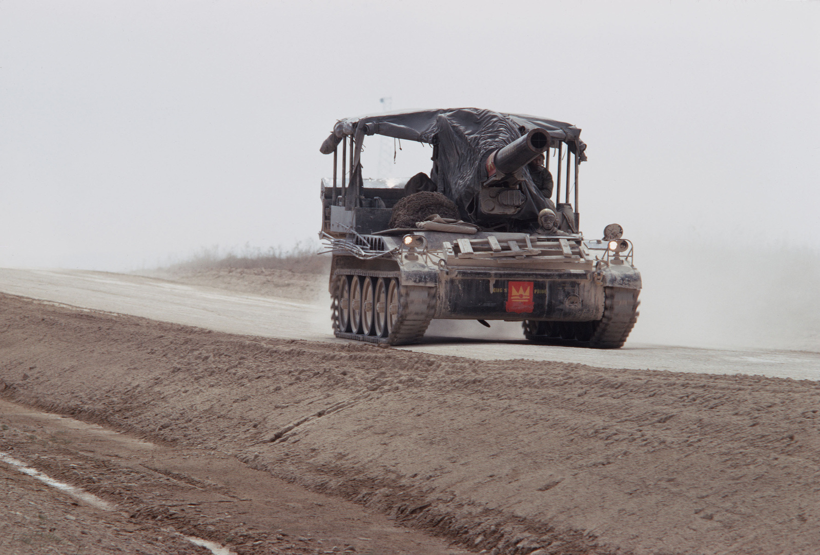 An M110 203 mm (8-inch) self-propelled howitzer moves down a road during a field training exercise
