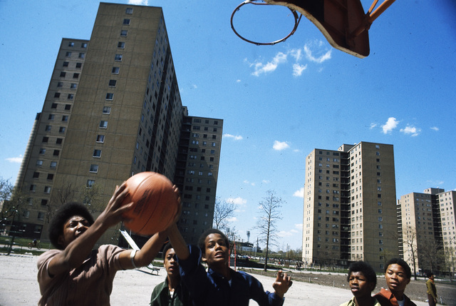 Black Youths Play Basketball at Stateway Gardens' Highrise Housing Project on Chicago's South Side, the Complex has Eight Buildings with 1,633 Two and Three Bedroom Apartments Housing 6,825 Persons, they were Built under the U.S. Housing Acts of 1949 and 1968 They are Managed by the Chicago Housing Authority which is Responsible for 41,500 Public Housing Dwellings